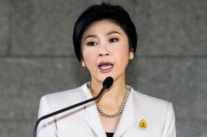 Prime Minister Yingluck Shinawatra answers questions from the media during a news conference in Bangkok